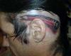 tatuaggi folli matita su orecchio