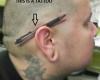 tatuaggi folli penna orecchio